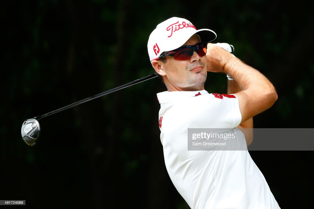 Tyrone Van Aswegen of South Africa plays his tee shot on the first hole during the third round of the HP Byron Nelson Championship at the TPC Four...