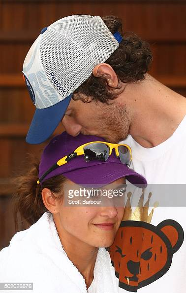 Tyrone Vickery AFL footballer from the Richmond Tigers and husband of Arina Rodionova kisses Arina Rodionova of Victoria after she lost her Women's...
