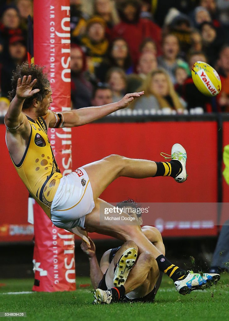 Tyrone Vickery of the Tigers kicks the ball for a goal during the round 10 AFL match between the Essendon Bombers and the Richmond Tigers at Melbourne Cricket Ground on May 28, 2016 in Melbourne, Australia.