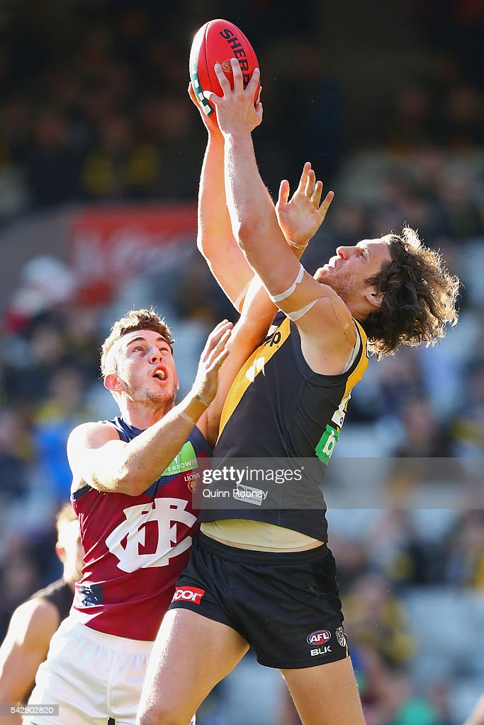 Tyrone Vickery of the Tigers marks over the top of Daniel McStay of the Lions during the round 14 AFL match between the Richmond Tigers and the Brisbane Lions at Melbourne Cricket Ground on June 25, 2016 in Melbourne, Australia.