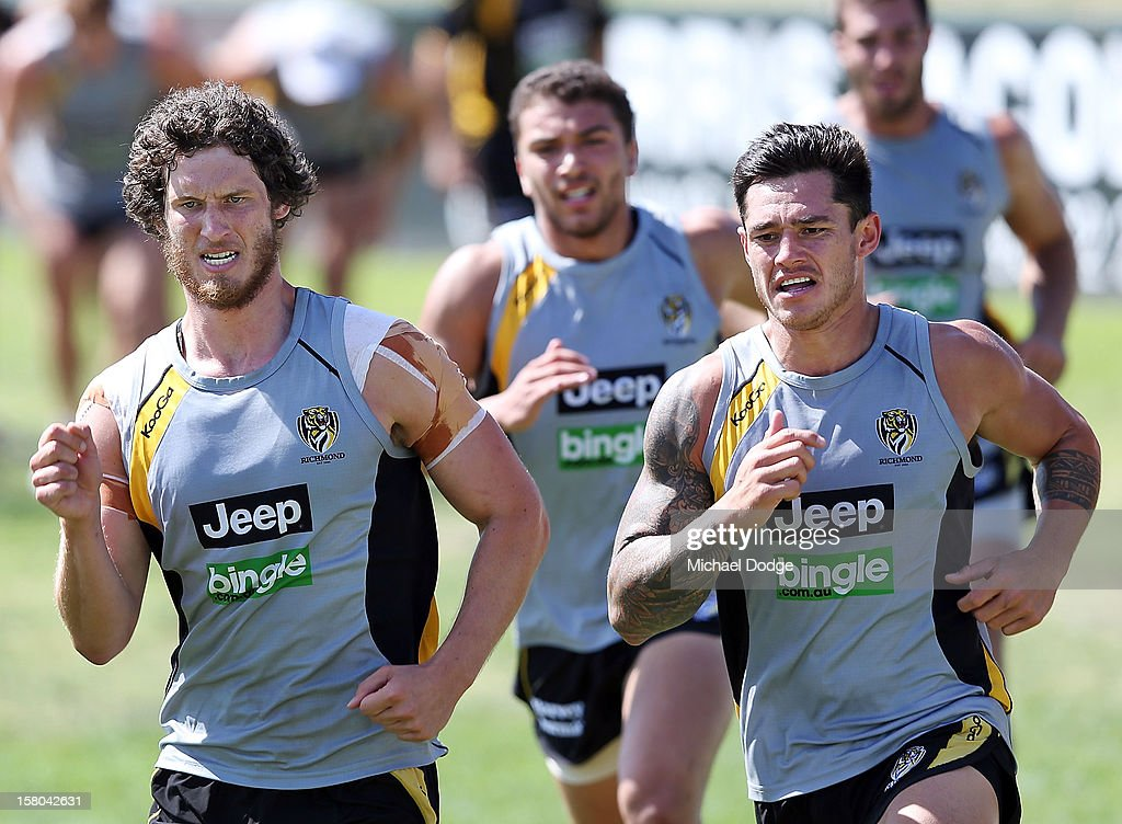 Tyrone Vickery (L) runs laps with Aaron Edwards during a Richmond Tigers AFL training session at Trevor Barker Beach Oval on December 10, 2012 in Melbourne, Australia.