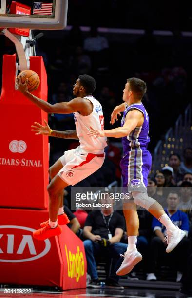 Tyrone Wallace of the Los Angeles Clippers attempts a lay up against Bogdan Bogdanovic of the Sacramento Kings on October 12 2017 at STAPLES Center...