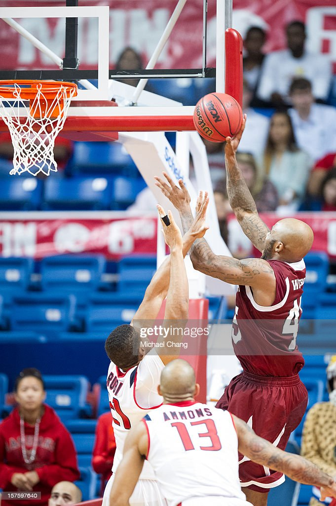 Tyrone Watson #45 of the New Mexico State Aggies attempts a layup over Augustine Rubit #21 of the South Alabama Jaguars at USA Mitchell Center on December 4, 2012 in Mobile, Alabama. New Mexico State defeated South Alabama 58-52.