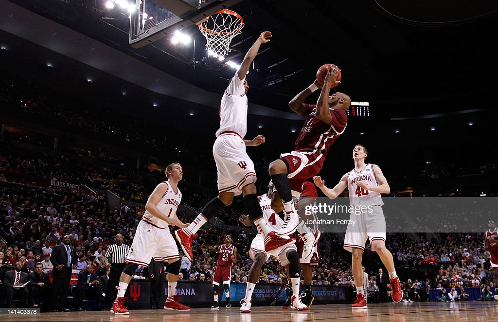 Tyrone Watson #45 of the New Mexico State Aggies shoots over Christian Watford #2 of the Indiana Hoosiers in the first half in the second round of the 2012 NCAA men's basketball tournament at Rose Garden Arena on March 15, 2012 in Portland, Oregon.