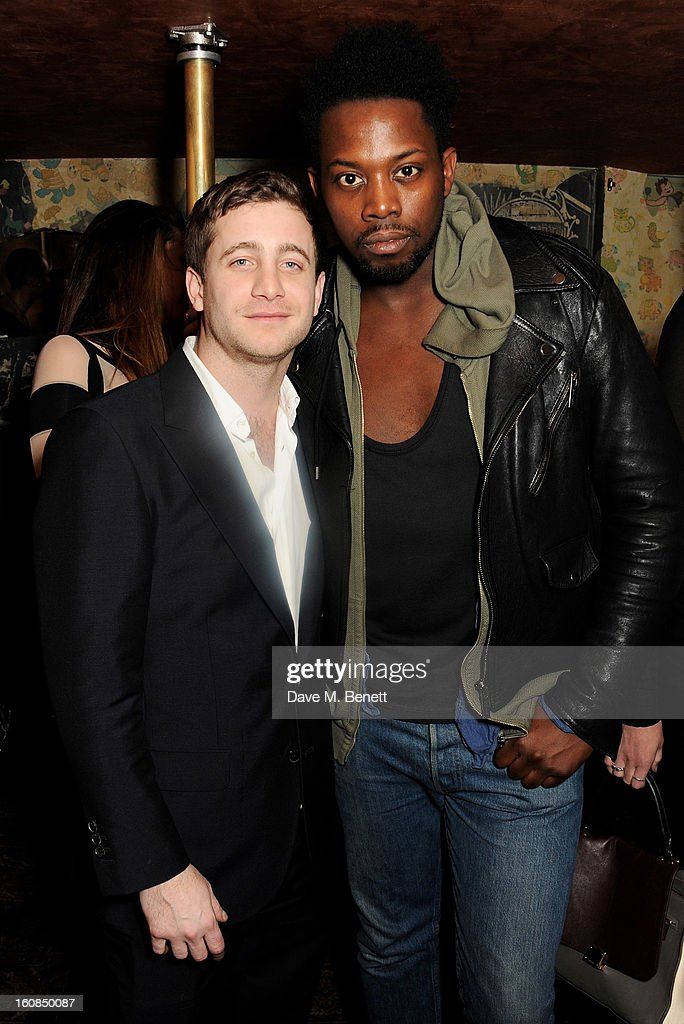 Tyrone Wood (L) and Adrien Sauvage attend the 2nd Anniversary of The Box with Belvedere Vodka on February 6, 2013 in London, England.