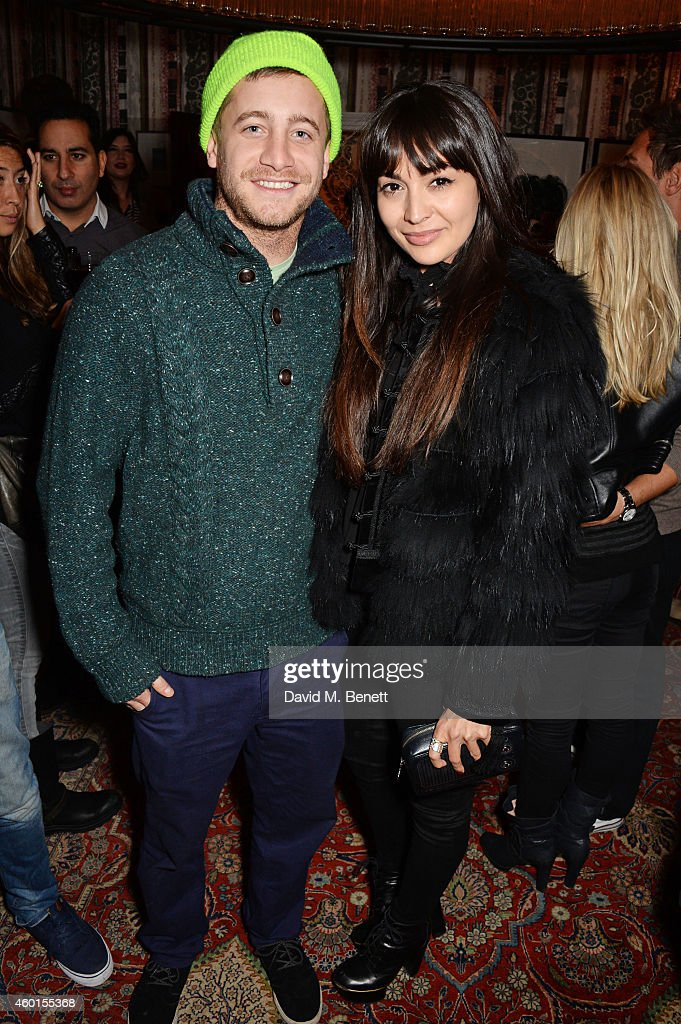 Tyrone Wood (L) and Zara Martin attend a VIP screening of 'St. Vincent' hosted by Poppy Delevingne at The Covent Garden Hotel on December 8, 2014 in London, England.