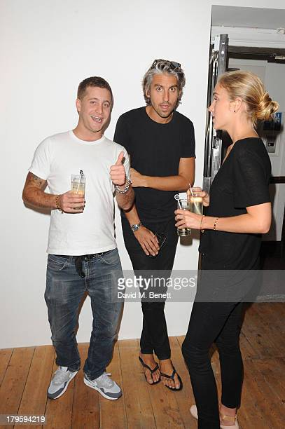 Tyrone Wood George Lamb and Beth Witson attends the VIP launch of the 'Hand To Earth' exhibition hosted by Matthew Williamson at Scream Gallery on...