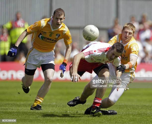 Tyrone's Philip Jordan is tackled by Antrim's Terry O'Neil during the Ulster Championship Football Final at St Tiernachs Park in Clones County...