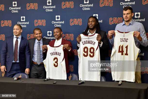 Tyronn Lue and General Manager Koby Altman of the Cleveland Cavaliers present Isaiah Thomas Jae Crowder and Ante Zizic with their new jersies at The...