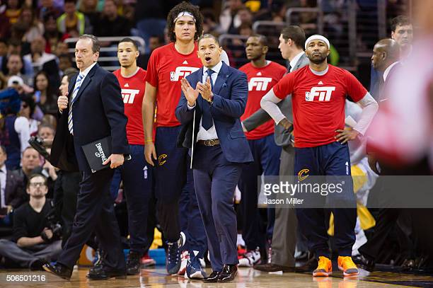 Tyronn Lue of the Cleveland Cavaliers reacts during a timeout during the second half against the Chicago Bulls at Quicken Loans Arena on January 23...
