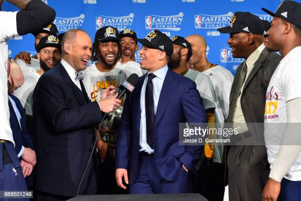 Tyronn Lue of the Cleveland Cavaliers talks with NBA TNT Analyst Ernie Johnson as the Cleveland Cavaliers are presented the Eastern Conference Finals...