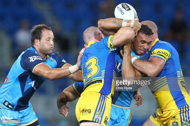 Tyronne RobertsDavis of the Titans is tackled during the round three NRL match between the Gold Coast Titans and the Parramatta Eels at Cbus Super...