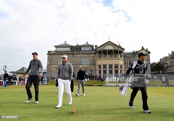 Tyrrell Hatton and Ross Fisher of England walk down the first hole during the final round of the Alfred Dunhill Links Championship at The Old Course...