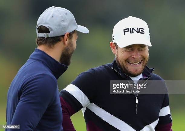 Tyrrell Hatton of England and Jamie Dornan Actor share a joke during the final round of the 2017 Alfred Dunhill Championship at The Old Course on...