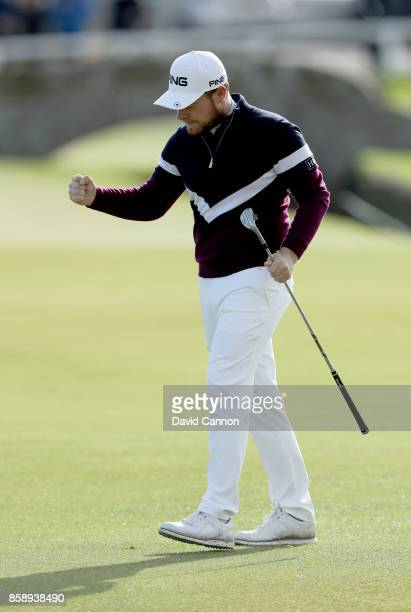Tyrrell Hatton of England celebrates after holing his fourth shot on the first hole during the final round of the 2017 Alfred Dunhill Links...