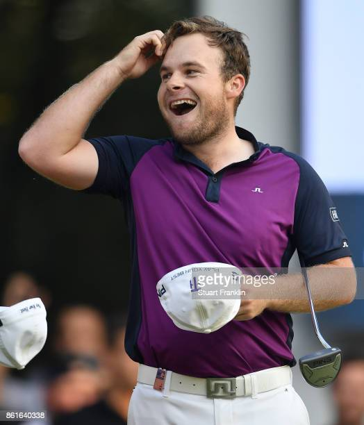 Tyrrell Hatton of England celebrates holeing the winning putt during the final round of The Italian Open at Golf Club Milano Parco Reale di Monza on...