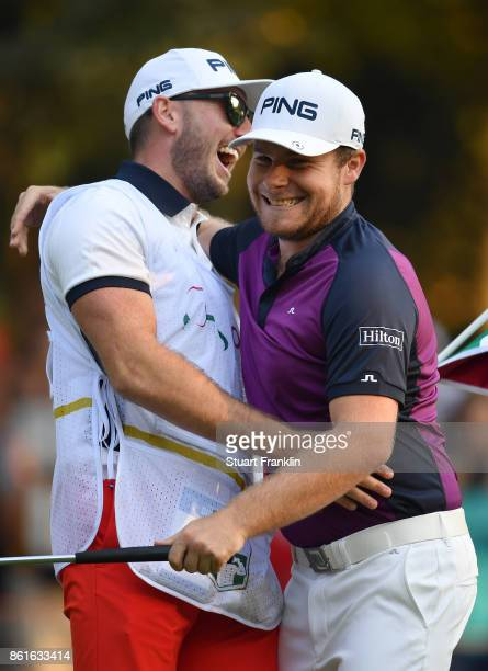 Tyrrell Hatton of England celebrates holeing the winning putt with his caddie Jonathan during the final round of The Italian Open at Golf Club Milano...