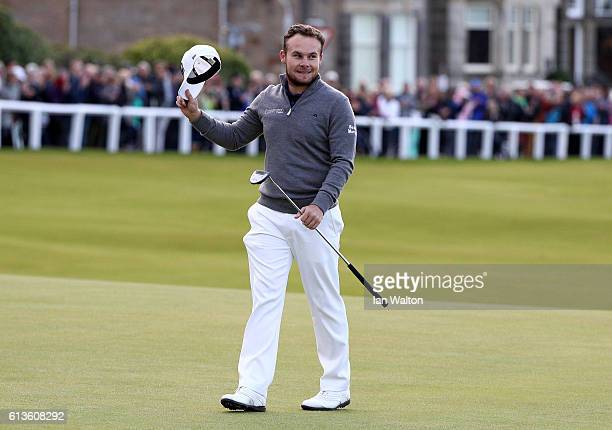 Tyrrell Hatton of England celebartes on the 18th green after winning the Alfred Dunhill Links Championship at The Old Course on October 9 2016 in St...