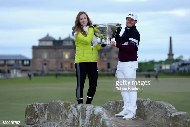 Tyrrell Hatton of England celebrates victory with his girlfriend Emily Braisher on the Swilken bridge following the final round of the 2017 Alfred...