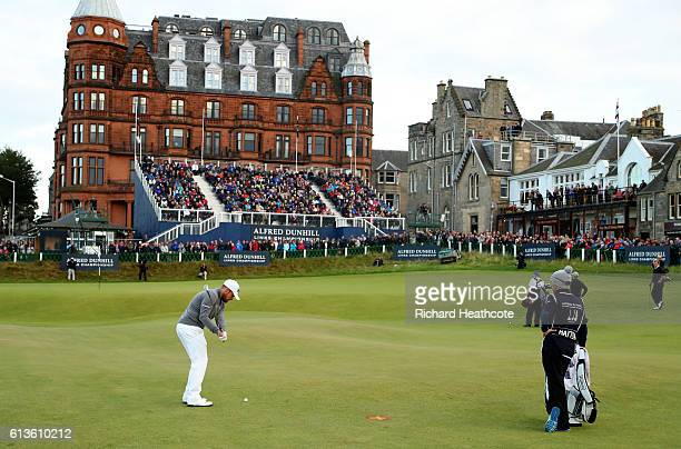 Tyrrell Hatton of England chips onto the 18th green during the final round of the Alfred Dunhill Links Championship at The Old Course on October 9...