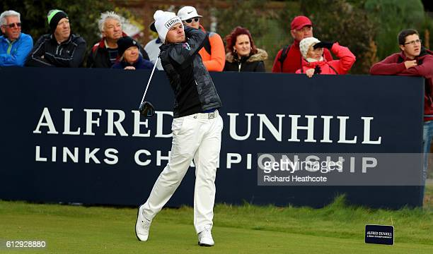 Tyrrell Hatton of England drives off the 10th tee during the first round of the Alfred Dunhill Links Championship on the Championship Course...