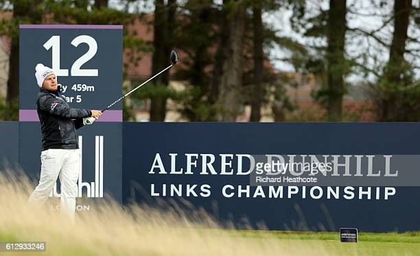 Tyrrell Hatton of England drives off the 12th tee during the first round of the Alfred Dunhill Links Championship on the Championship Course...