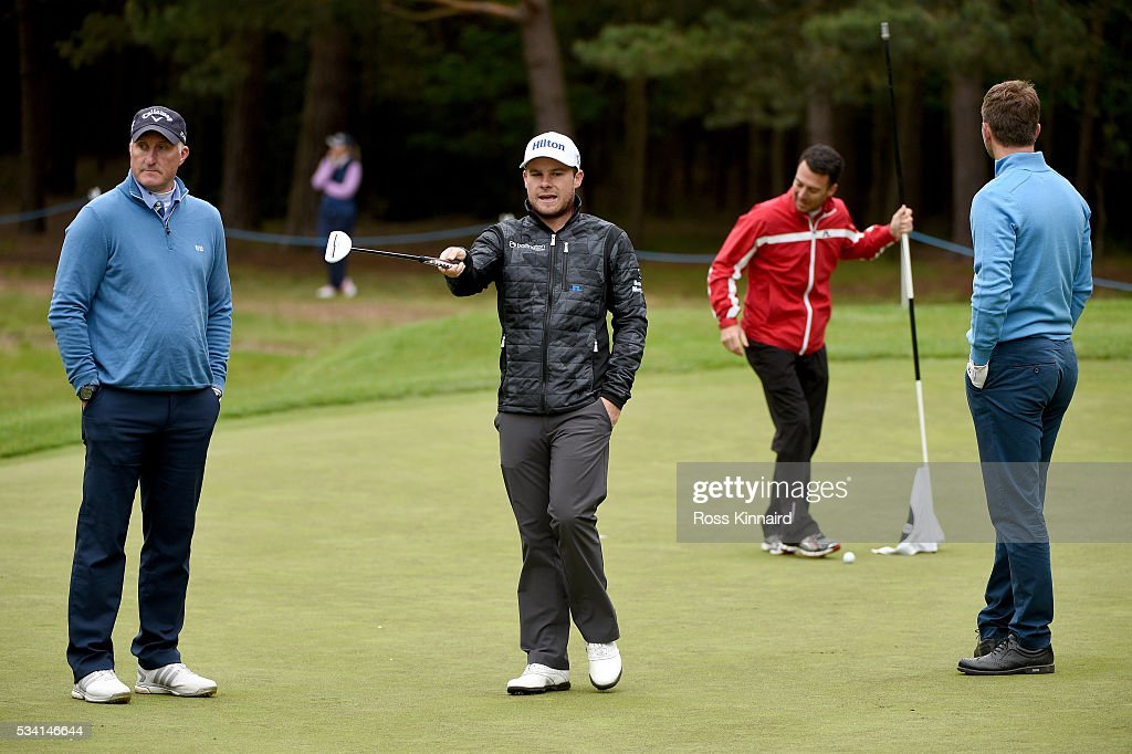 <a gi-track='captionPersonalityLinkClicked' href=/galleries/search?phrase=Tyrrell+Hatton&family=editorial&specificpeople=7104399 ng-click='$event.stopPropagation()'>Tyrrell Hatton</a> of England gestures during the Pro-Am prior to the BMW PGA Championship at Wentworth on May 25, 2016 in Virginia Water, England.