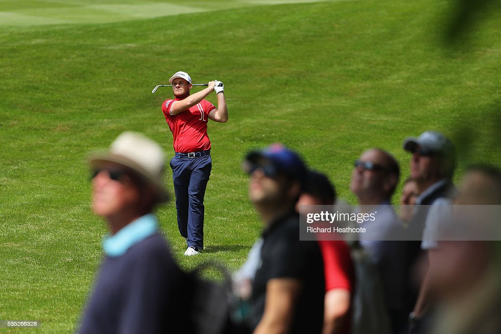 <a gi-track='captionPersonalityLinkClicked' href=/galleries/search?phrase=Tyrrell+Hatton&family=editorial&specificpeople=7104399 ng-click='$event.stopPropagation()'>Tyrrell Hatton</a> of England hits an approach during day four of the BMW PGA Championship at Wentworth on May 29, 2016 in Virginia Water, England.