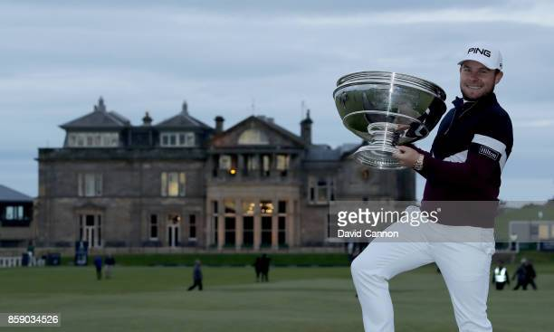 Tyrrell Hatton of England holds the trophy after his victory the final round of the 2017 Alfred Dunhill Links Championship on the Old Course at St...