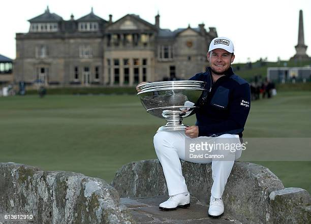 Tyrrell Hatton of England holds the trophy on the Swilken Bridge on the 18th hole after winning the Alfred Dunhill Links Championship at The Old...