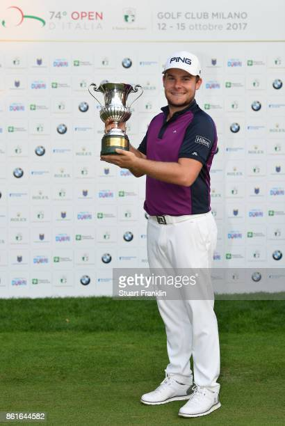 Tyrrell Hatton of England holds the winners trophy after the final round of The Italian Open at Golf Club Milano Parco Reale di Monza on October 15...