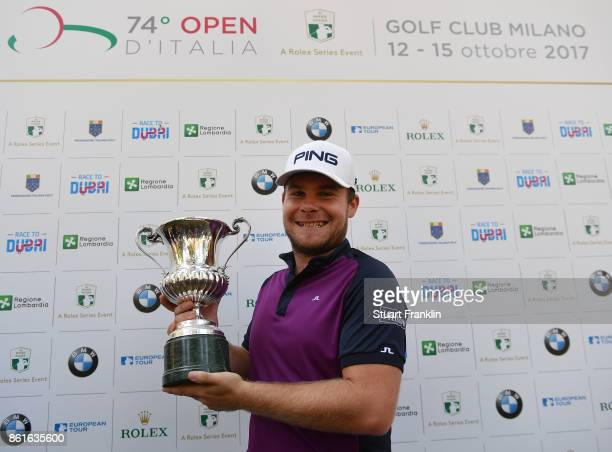 Tyrrell Hatton of England holds the winners trophy after winning The Italian Open at Golf Club Milano Parco Reale di Monza on October 15 2017 in...