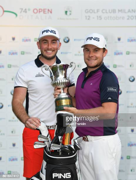 Tyrrell Hatton of England holds the winners trophy with his caddie Johnathan Bell after the final round of The Italian Open at Golf Club Milano Parco...