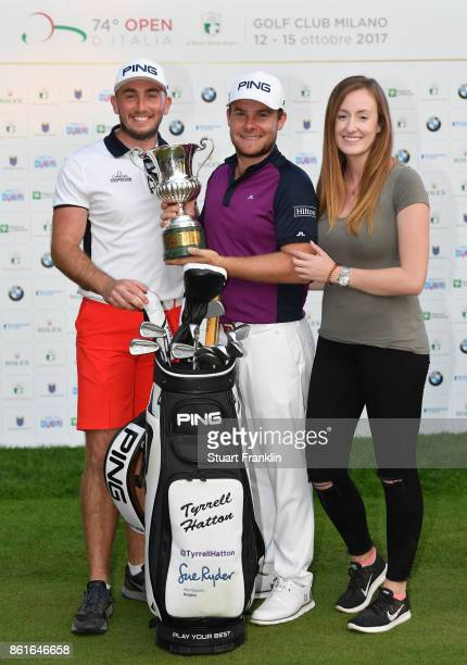 Tyrrell Hatton of England holds the winners trophy with his girlfriend Emily Braisher and caddie Johnathan Bell after the final round of The Italian...