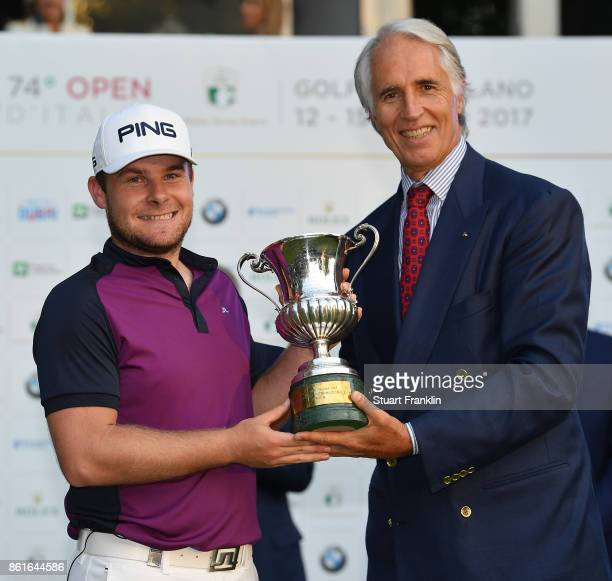 Tyrrell Hatton of England is presented with the winners trophy after the final round of The Italian Open at Golf Club Milano Parco Reale di Monza on...