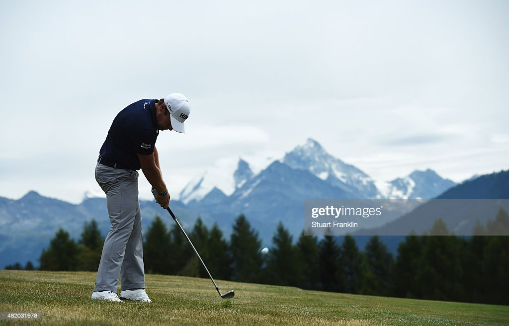 Tyrrell Hatton of England plays a shot during the final round of the Omega European Masters at CranssurSierre Golf Club on July 26 2015 in...