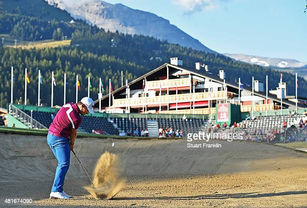 Tyrrell Hatton of England plays a shot during the first round of the Omega European Masters at CranssurSierre Golf Club on July 23 2015 in...