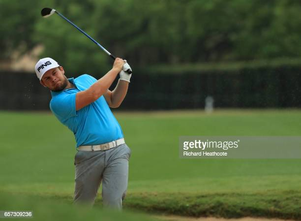 Tyrrell Hatton of England plays a shot from a bunker on the 6th hole of his match during round three of the World Golf ChampionshipsDell Technologies...