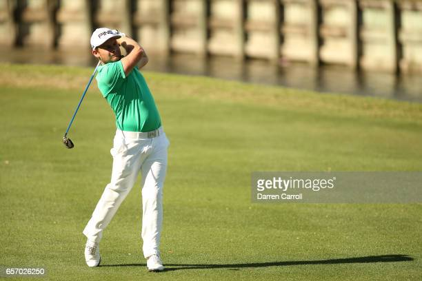 Tyrrell Hatton of England plays a shot on the 16th hole of his match during round two of the World Golf ChampionshipsDell Technologies Match Play at...