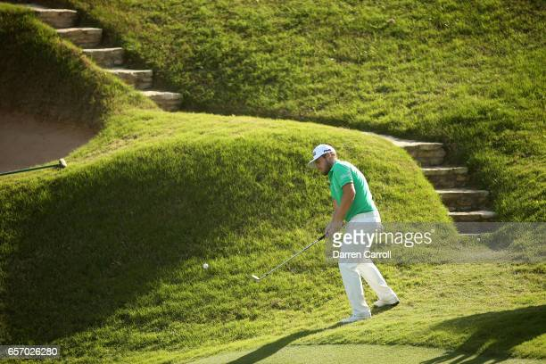 Tyrrell Hatton of England plays a shot on the 17th hole of his match during round two of the World Golf ChampionshipsDell Technologies Match Play at...
