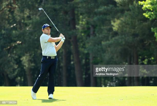 Tyrell Hatton of England plays an iron shot during the BMW PGA Championship ProAM at Wentworth on May 24 2017 in Virginia Water England
