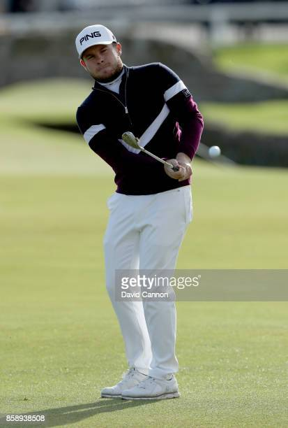 Tyrrell Hatton of England plays his fourth shot on the first hole during the final round of the 2017 Alfred Dunhill Links Championship on the Old...