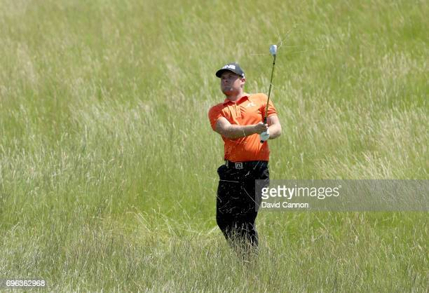 Tyrrell Hatton of England plays his second shot from deep rough on the par 4 15th hole during the first round of the 117th US Open Championship at...