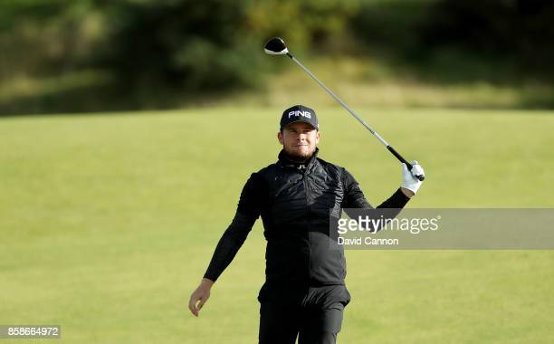 Tyrrell Hatton of England plays his second shot on the ninth hole during the third round of the 2017 Alfred Dunhill Links Championship on the...