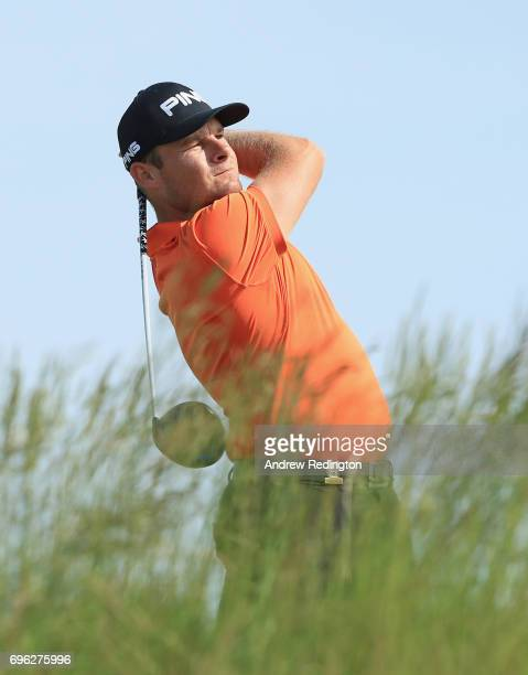 Tyrell Hatton of England plays his shot from the fifth tee during the first round of the 2017 US Open at Erin Hills on June 15 2017 in Hartford...