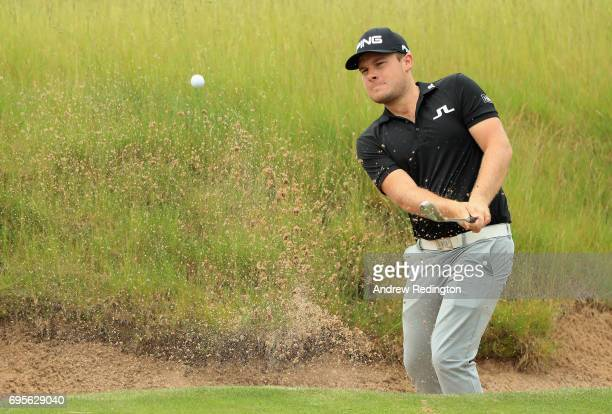 Tyrrell Hatton of England plays his shot on the 16th hole during a practice round prior to the 2017 US Open at Erin Hills on June 13 2017 in Hartford...