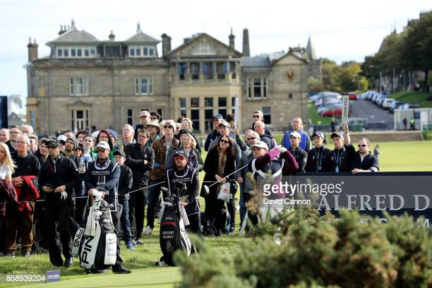 Tyrrell Hatton of England plays his tee shot on the second hole watched by his playing partner Gregory Bourdy of France during the final round of the...