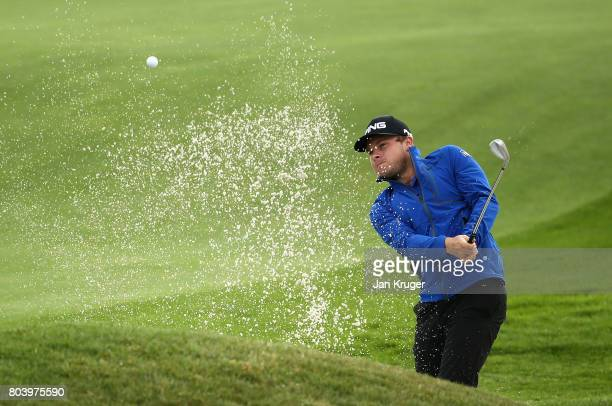 Tyrell Hatton of England plays out of the bunker on the 14th during day two of the HNA Open de Feance at Le Golf National on June 30 2017 in Paris...