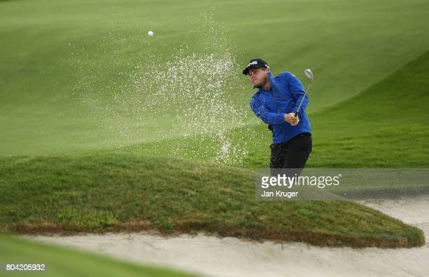 Tyrell Hatton of England plays out of the bunker on the 14th during the second round of the HNA Open de France at Le Golf National on June 30 2017 in...