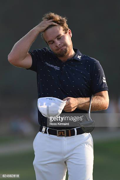 Tyrrell Hatton of England reacts on the 18th green during day four of the DP World Tour Championship at Jumeirah Golf Estates on November 20 2016 in...
